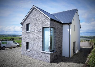 ICF house with slate cladding
