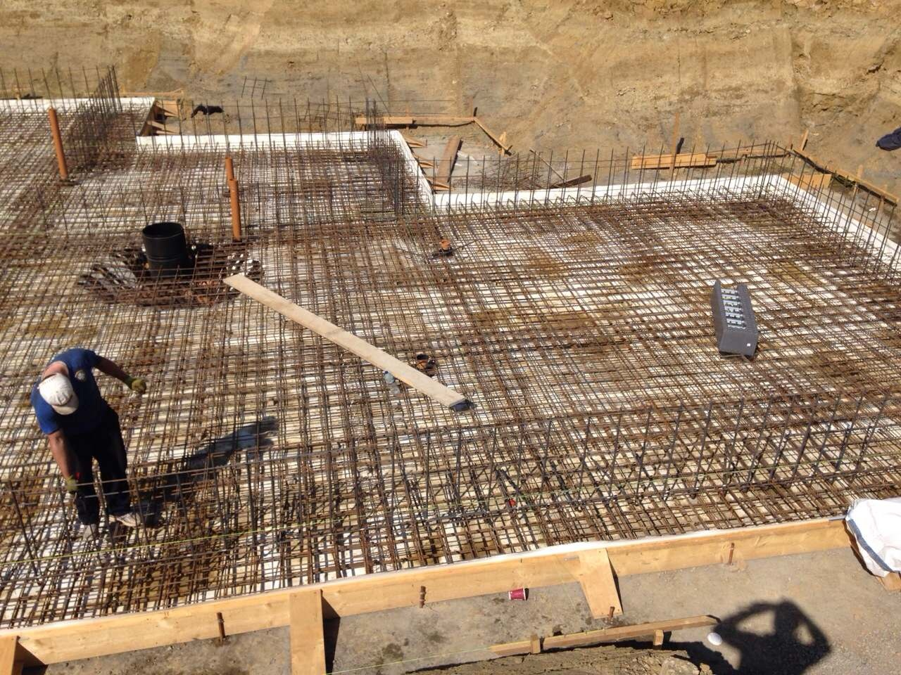 Formation of the raft foundation using concrete and rebar steel
