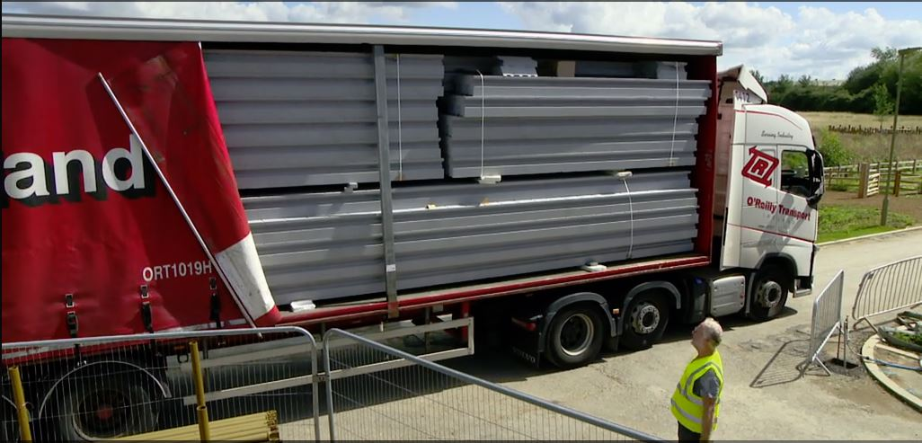 This is an image of thermoroof panels being delivered