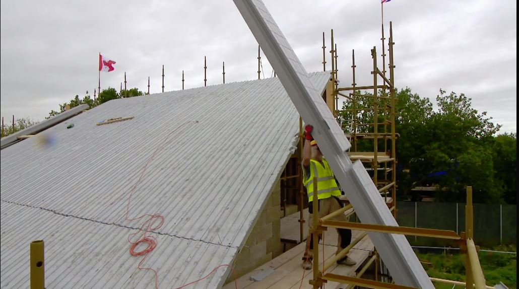 This is an image of thermoroof panels being installed